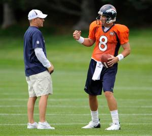 Josh McDaniels and Kyle Orton (8), the Broncos new head coach and quarterback.