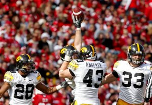 Iowa's D celebrates one of 3 interceptions against Wisconsin Saturday